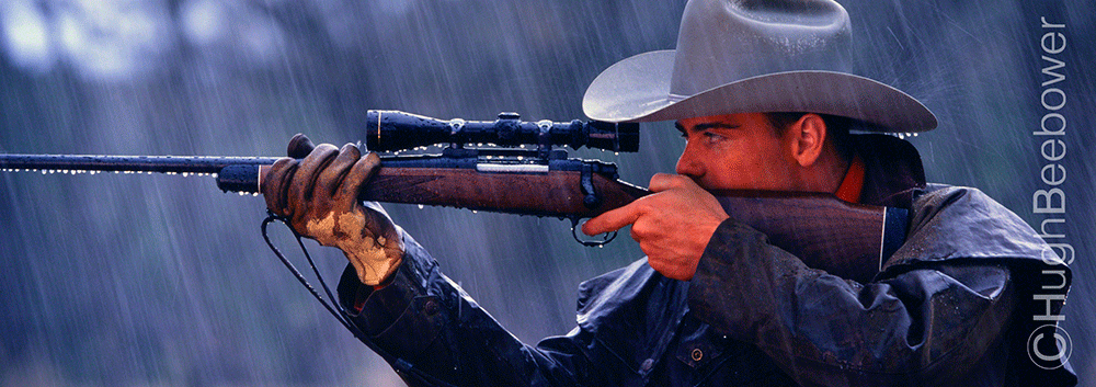 Hunter with Rifle in the Rain | Beebower Productions